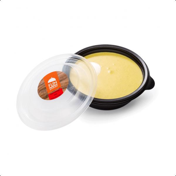 Kerriesoep met fijne kruiden voor slikproblemen eiwitverrijkt van fijnproevers productfoto
